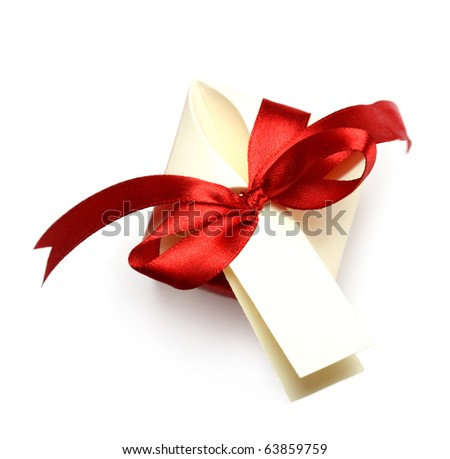 gift box tied with a red ribbon bow - stock photo