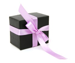 gift box with a ribbon on a pink background