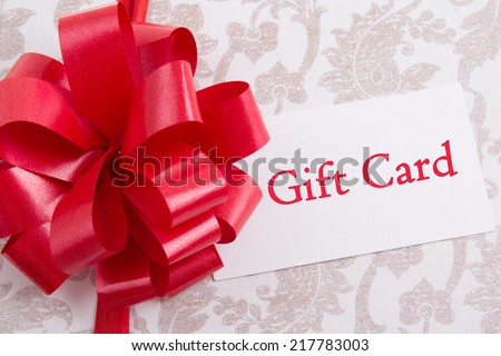 gift box with big red bow and gift card