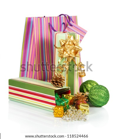 Gift box with christmas tinsel, balls and package isolated on white