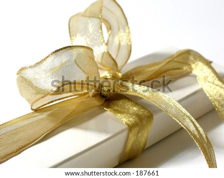 Gift box with gold ribbon and bow