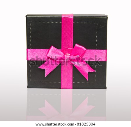 Gift Box With Pink Bow On White Background