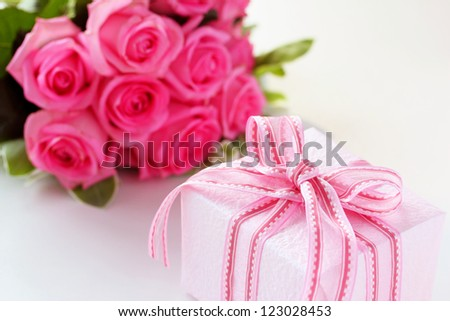 Gift box with pink rose bouquet for valentines day
