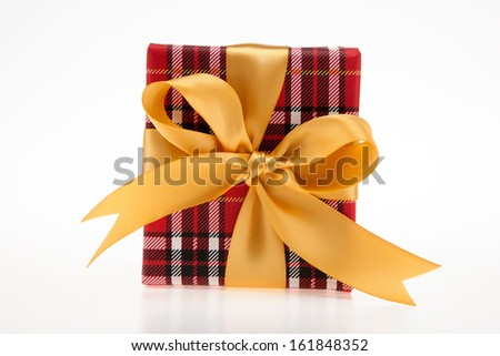 Gift box with red check print with golden ribbon