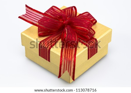 Gift box with red ribbon and white background