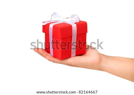 gift box with red ribbon in hand