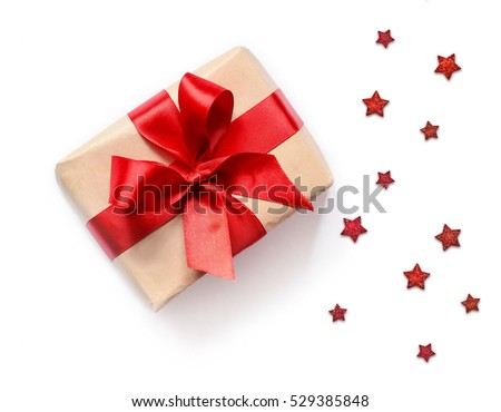 Gift box with red ribbon on white background. Christmas present. #529385848