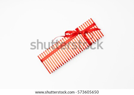 gift box with red stripes and a bow, Valentines day, mother day concept #573605650