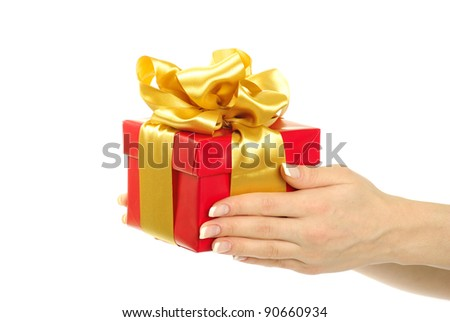 gift box with ribbon in hands - stock photo
