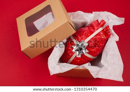 Gift box with the realistic heart inside as a gift. Love, marriage, proposal humoristic concept #1310354470
