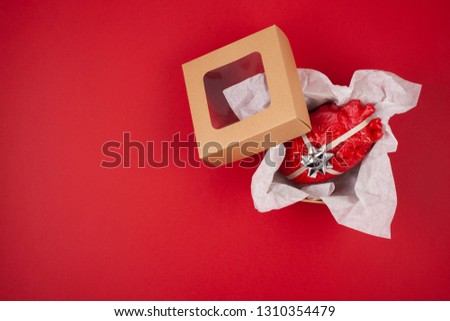Gift box with the realistic heart inside as a gift. Love, marriage, proposal humoristic concept #1310354479