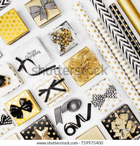 gift box wrapped in black and gold paper on a white background for christmas new