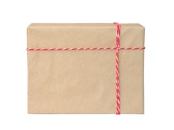 Gift box wrapped in brown recycled paper with red and white rope. Present, packaging.
