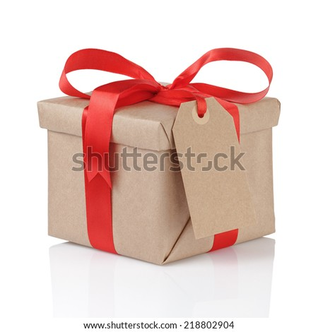 gift box wrapped with kraft paper and red bow with tag for text isolated