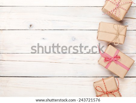 Gift boxes on wooden table background with copy space