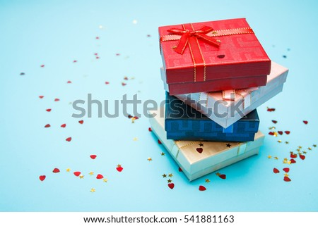 Gift boxes with bows on blue background   - Shutterstock ID 541881163
