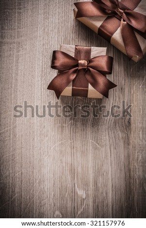 gift boxes with brown ribbons...