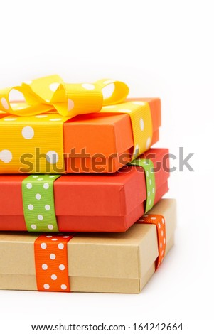 Gift boxes with colorful dotted ribbons