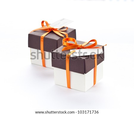 Gift boxes with orange ribbon and bow.