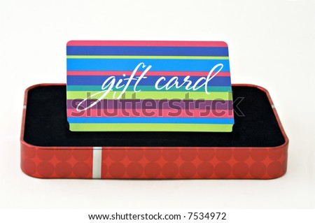 Gift card displayed in a gift box isolated on a white background