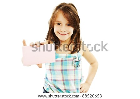 Gift card sign little girl. Excited little girl showing empty blank paper note copy space. Isolated on white background