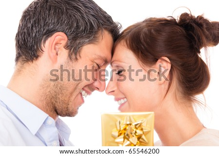 Gift couple holding present closed eyes