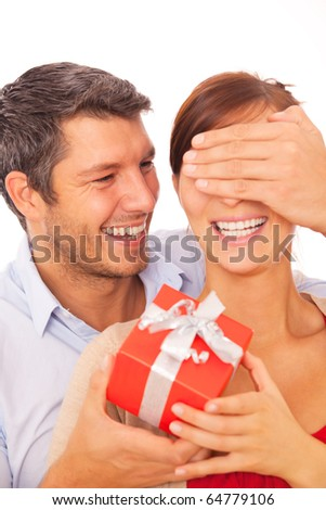 Gift couple holding present closing someone eyes