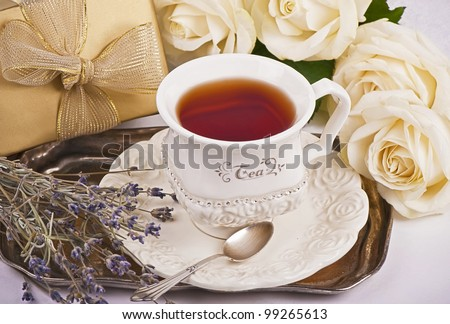 Gift, cup of tea, white roses, dry lavender