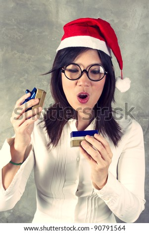 Gift for Santa, female Santa opening gift box with surprise action.