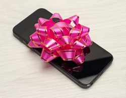 Gift for the holidays phone with a bow