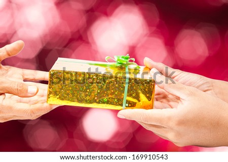 Gift giving on red background
