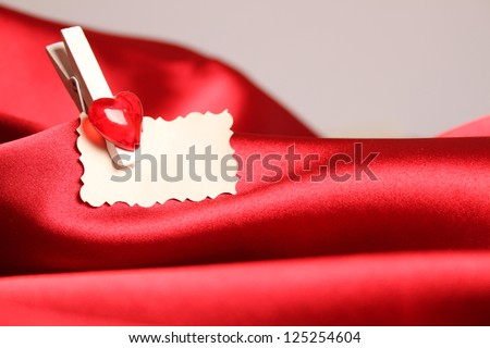 Gift greeting card for Valentine's Day, on a red silk