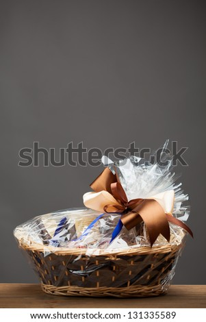gift in a basket, grey background
