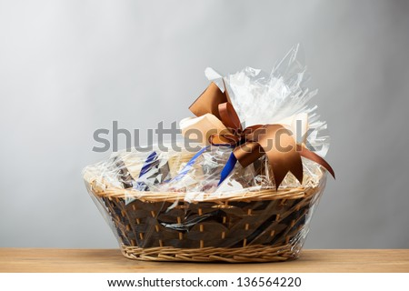 gift in a basket, grey background Stock photo ©