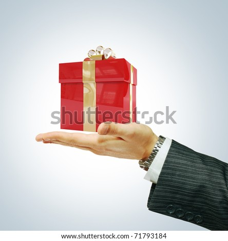 Gift in businessman's hand