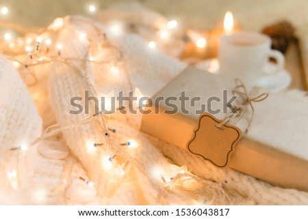Gift in cozy room. Cold day in warm house. Concept Hygge. Merry Christmas! #1536043817