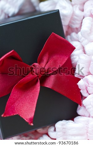 gift in packaging peanuts with a bow ready to gift
