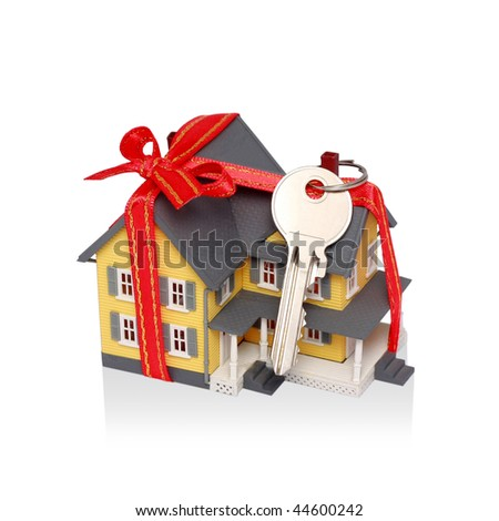Gift miniature house with red ribbon and key isolated on white background with reflection - Including clipping path. You can easily remove reflection if you want by clipping path.