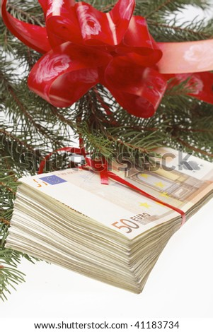 Gift money with red ribbon - stock photo