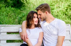 gift of love. valentines day. summer camping in wood. family rancho weekend. romantic date. man with girl in park. couple relax outdoor on bench. Togetherness concept. couple in love. Casual fashion.