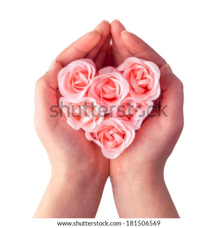 Gift of natural soap rose heart on a white background