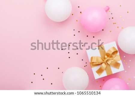 Gift or present box, balloons and confetti on pink table top view. Flat lay composition for birthday, mother day or wedding. #1065510134