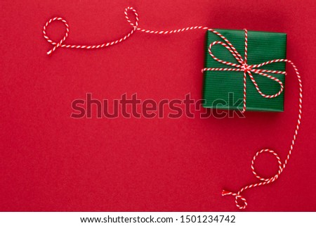 Gift or present box on color table top view. Flat lay composition for birthday, mother day or wedding.