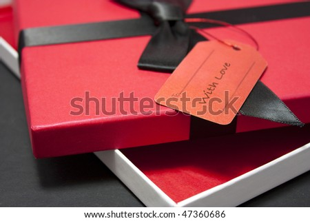 Gift or present with red box in a box with blank label