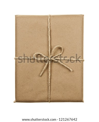 Gift package in brown paper wrapper tied with twine isolated on white background - stock photo