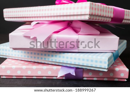 Gift packages tied with ribbons on black background