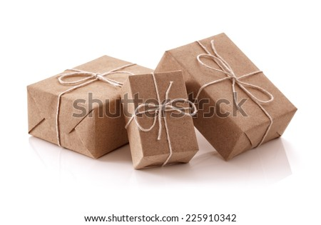 Gift packages wrapped in brown recycled paper isolated on white #225910342