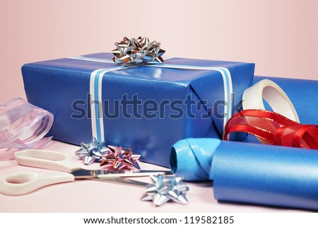 Gift packing materials isolated over pink background