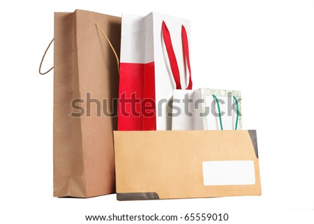 gift. paper bag and envelope over white background