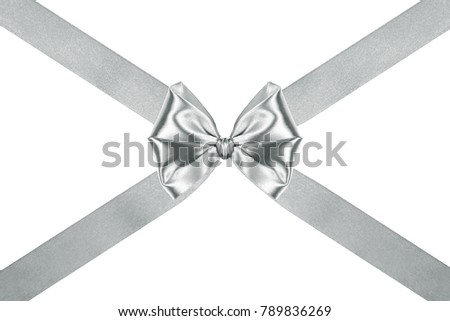 Gift ribbon glossy silver satin bow with crosswise ribbons isolated over white background, side view #789836269